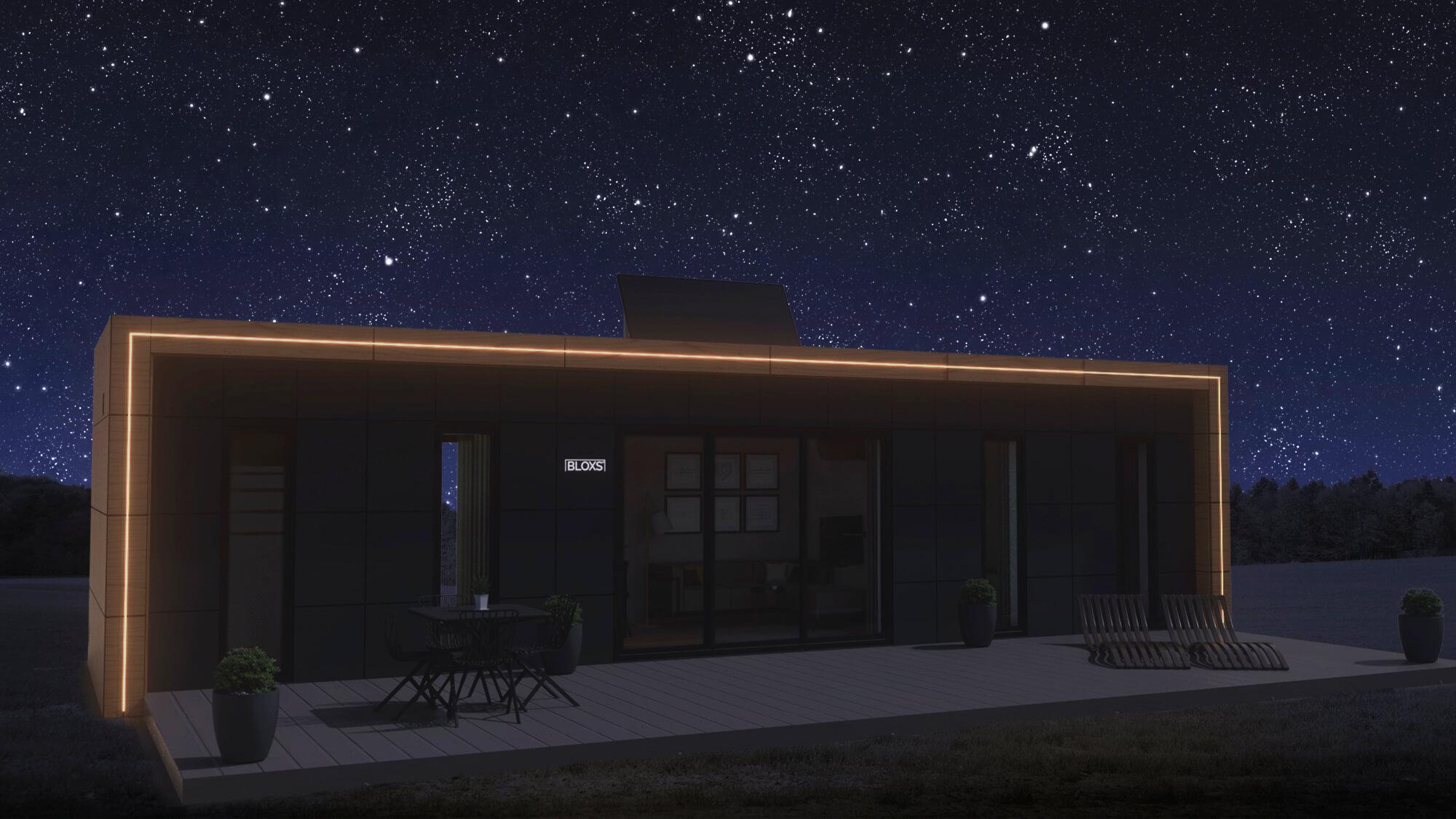 Tiny House BLOXS bei Nacht mit LED Lichtsignatur