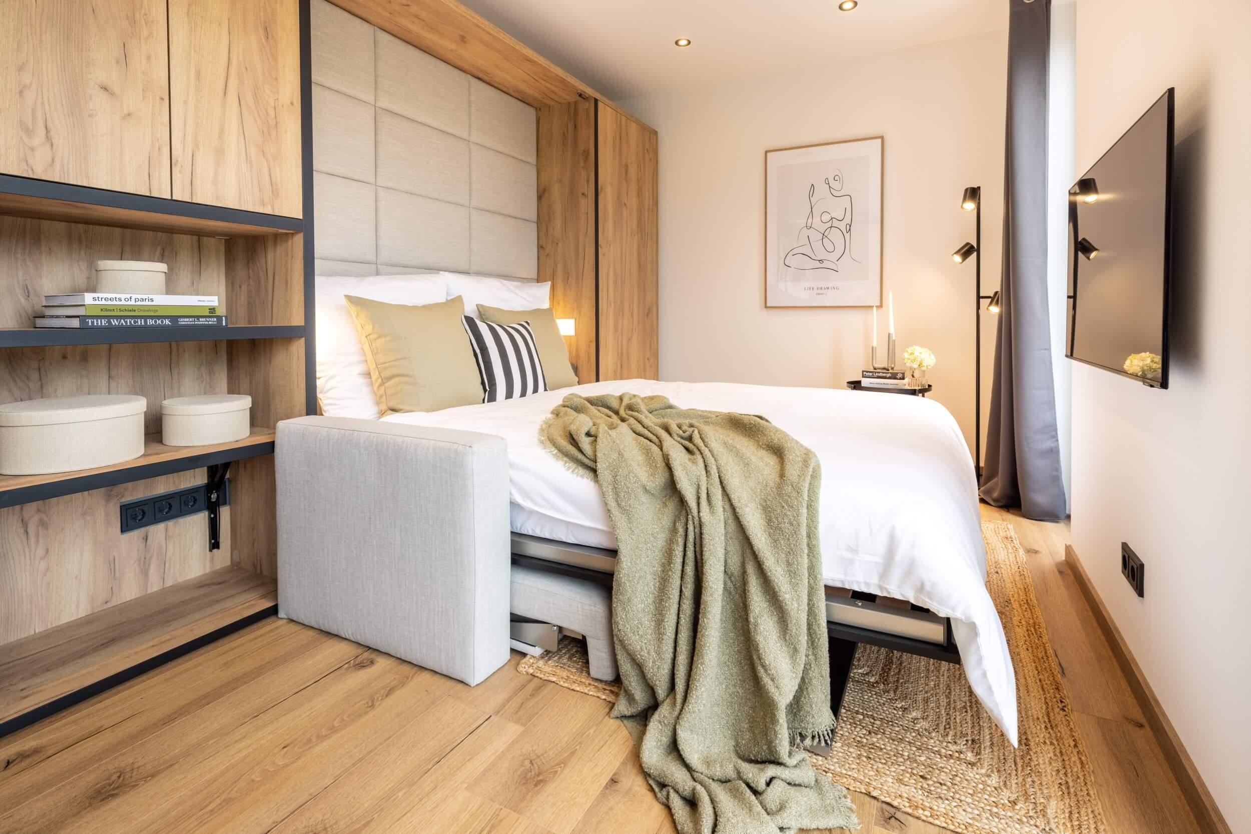Tiny House BLOXS Sofa und Wandschrank mit integriertem Bett